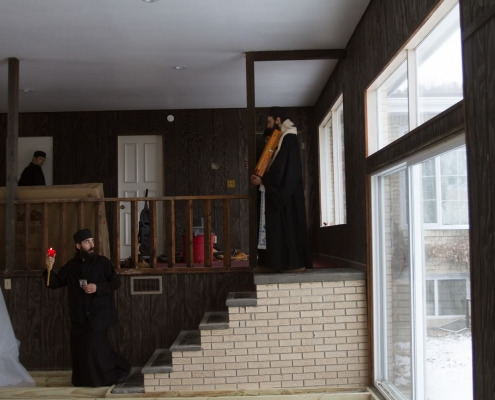Procession with the Holy Icon of Saint Nicholas - stairs leading to our soon-to-be trapeza and kitchen.