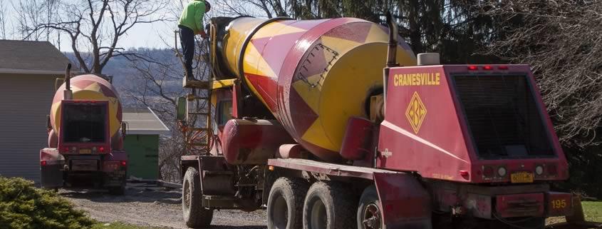 Concrete trucks getting ready to pour
